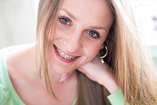 blonde lady smiling with braces